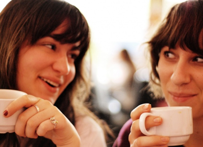 two women talking over coffee
